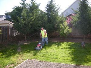 chris mowing lawn