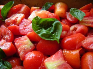 quarted tomatoes with basil